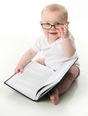 baby_with_glasses_with_book.jpg